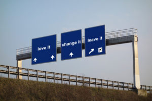 A photo of road signs showing we have the choice to love, change or leave situations.