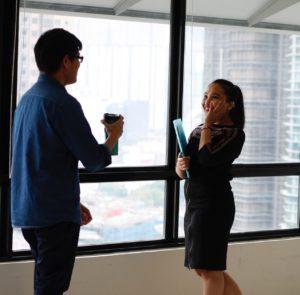 Man and woman talking at work